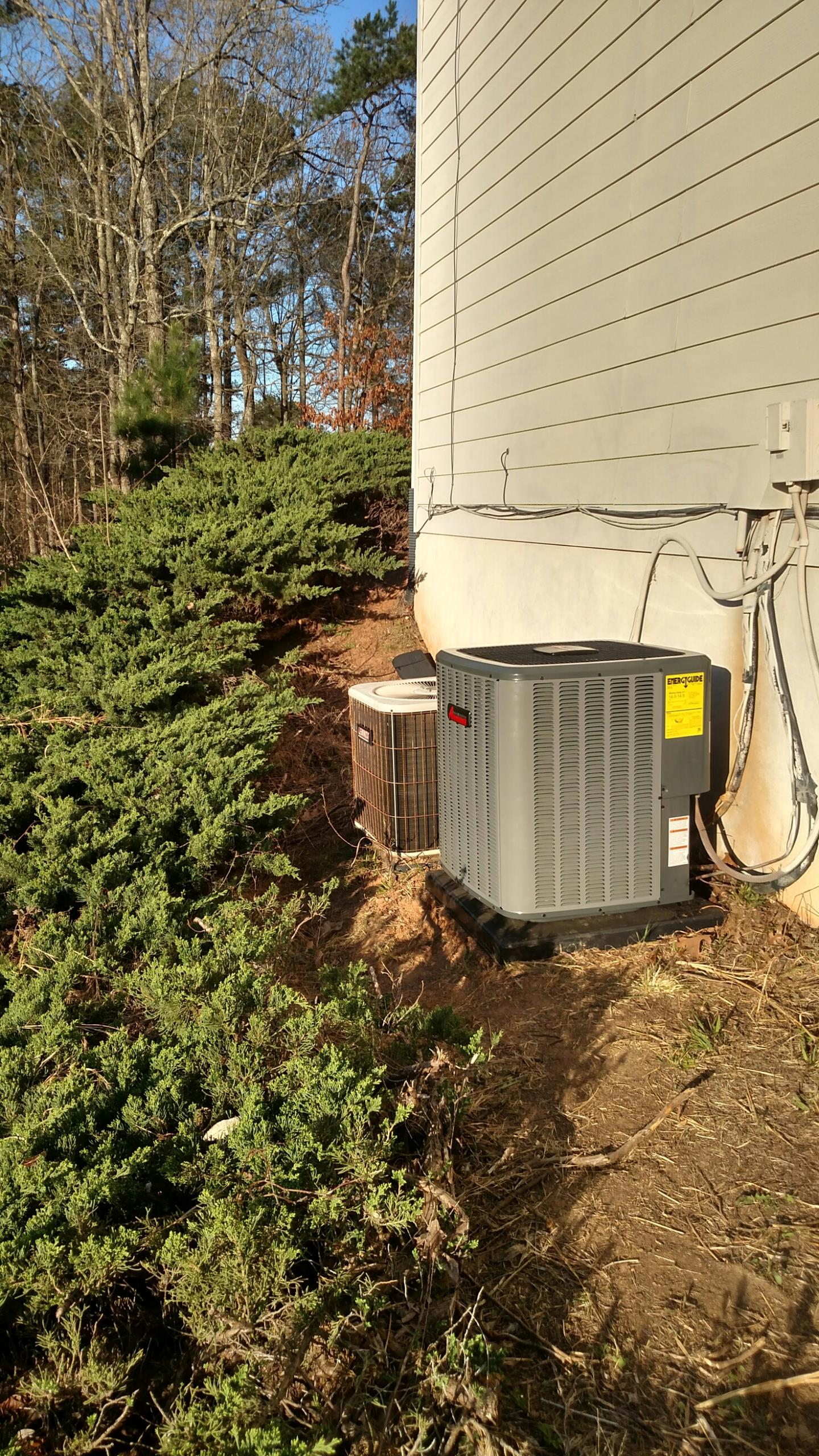 Suwanee, GA - Replacing the system on the left today. We are installing a 14 seer Amana a/c and coil. We replaced the one on the right yesterday March 17 2016.