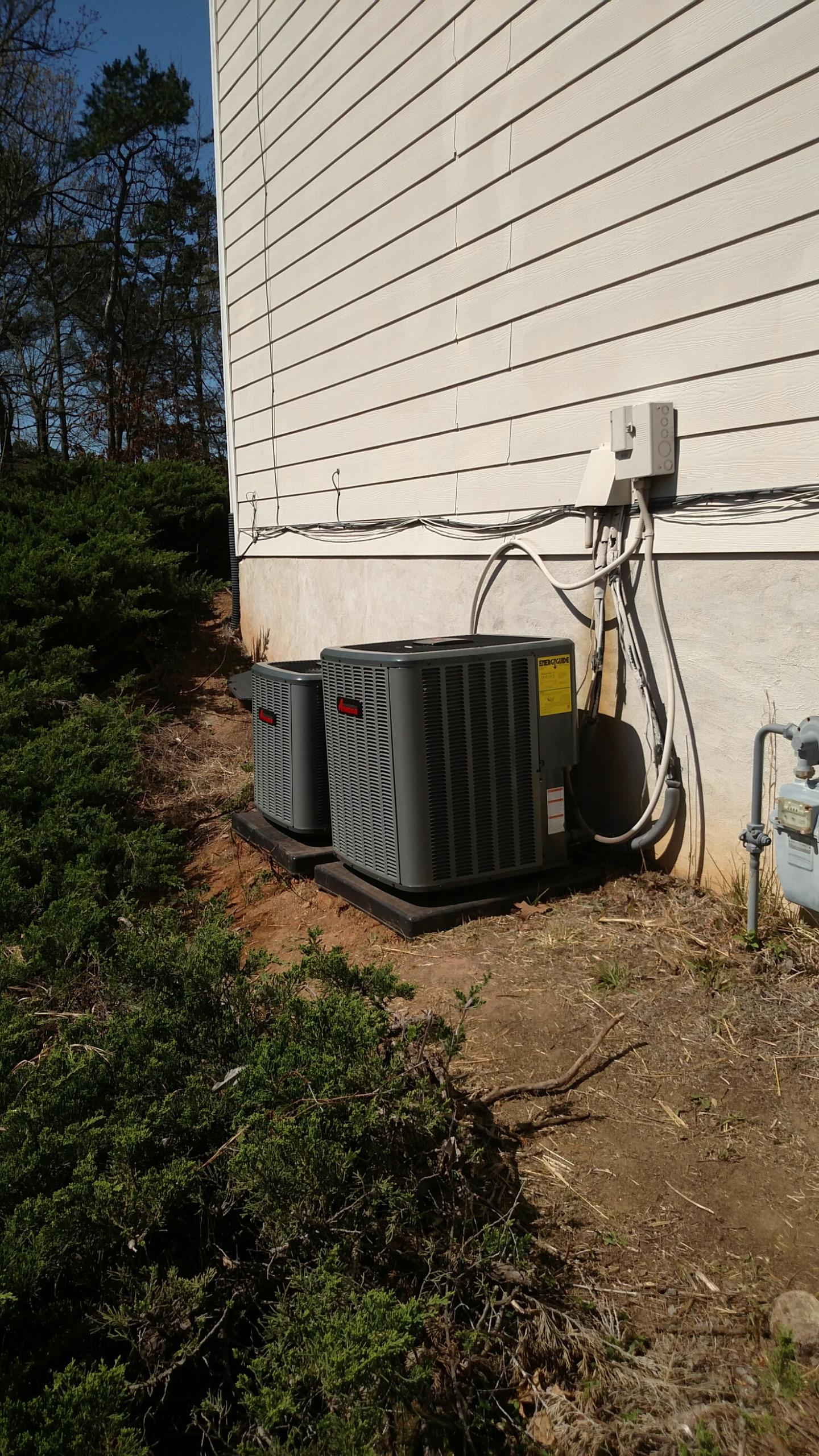 Suwanee, GA - Completing the installation on these 2 14 seer Amana air conditioners.