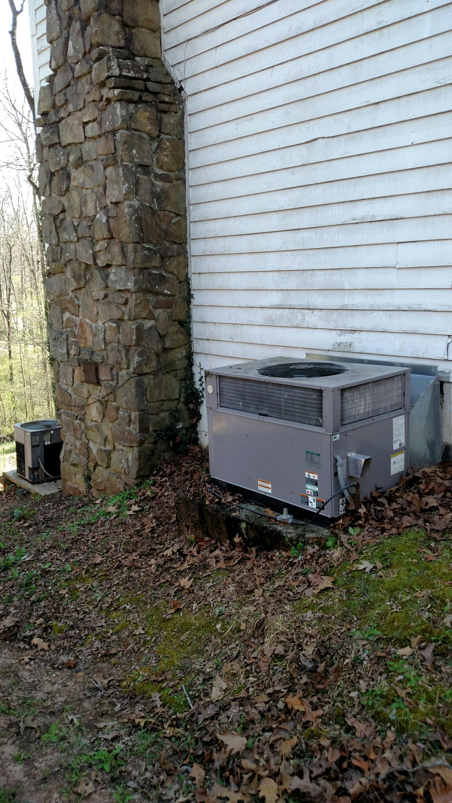 Oakwood, GA - Checking these two central heating and cooling systems to make sure they are ready for summer.