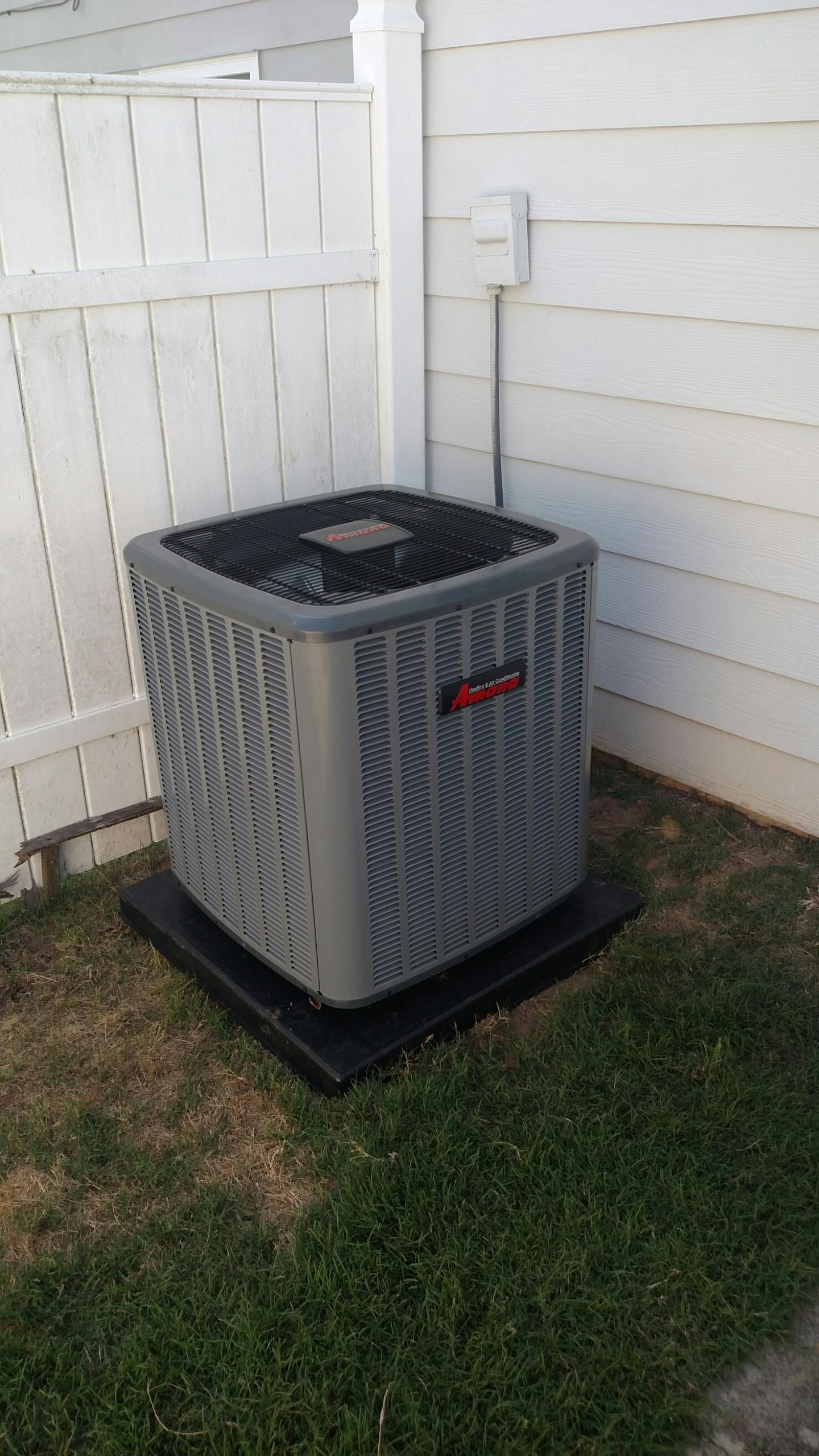 Oakwood, GA - Installing this new Amana 14 seer central heating and cooling system. New unit has a 10 year all parts warranty
