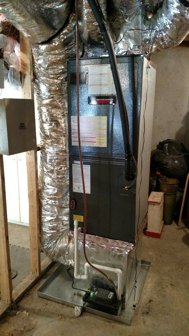 Braselton, GA - Installing this new 14 seer Amana 3 ton heat pump. New system has a 10 year all parts warranty through Amana. This new system is 30-40% more efficient than the old system we took out.