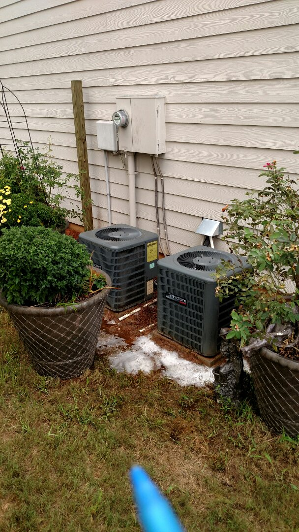 Braselton, GA - Performing cooling checks on these two Amana central heating and cooling systems. Chemical flushing condenser coils and changing customer supplied filters. Checking freon readings and repairing low voltage wire problem.