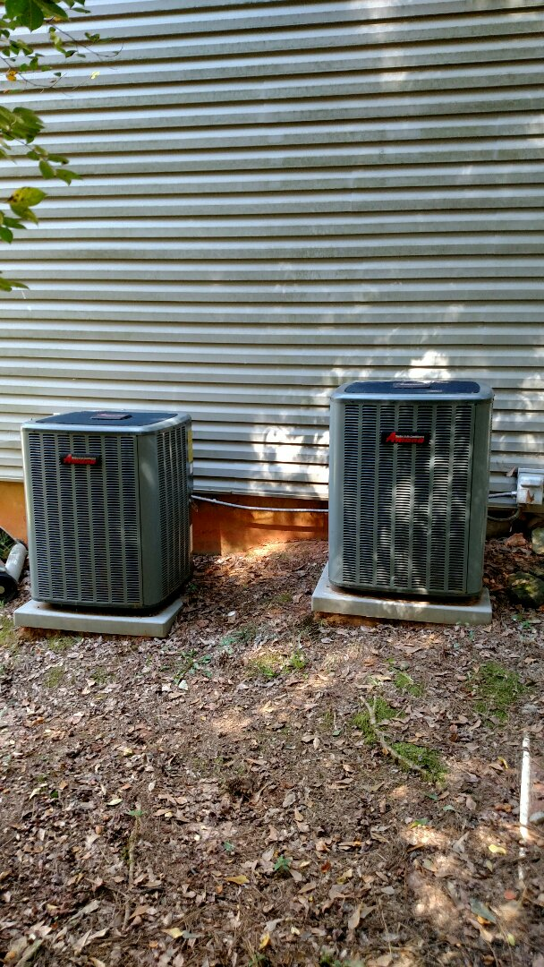 Braselton, GA - Performing heating maintenance on these two 8 year old Amana heat pump systems that we installed in 2008. Checking and replacing 5 inch pleated media filters as necessary. Also testing defrost cycles and backup strip heat. Checking freon readings and testing electrical components.