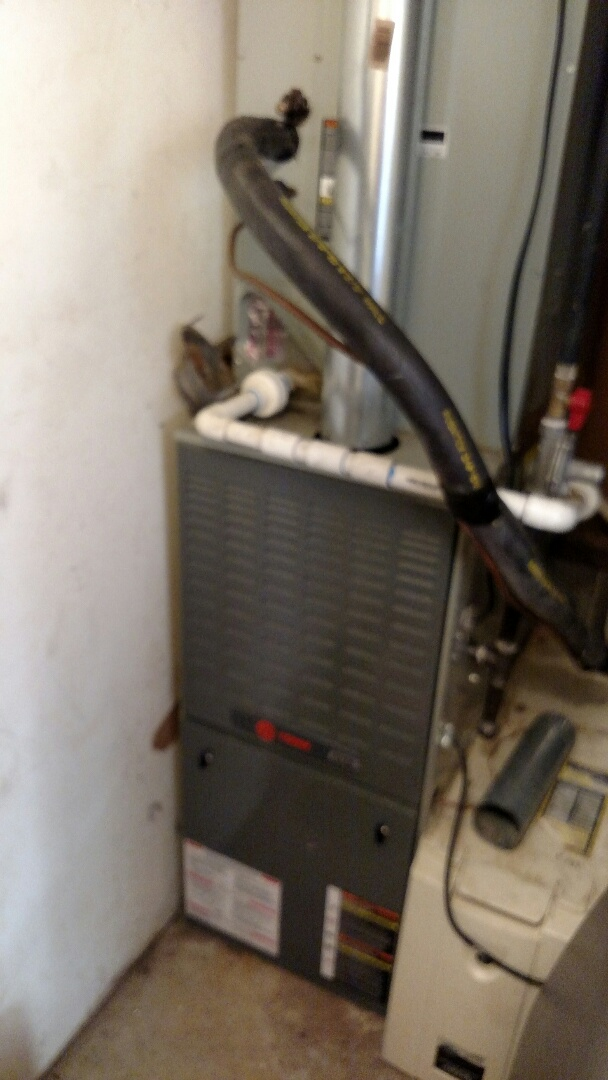 Oakwood, GA - Performing heating maintenance on this 12 year old Trane 80% natural gas furnace. We installed this system back in 2004. We are local and have been servicing this area for over 13 years. We are in or near this area on almost a daily basis. If your looking for a honest and reputable heating and air conditioning family owned business to serve you give us a call.