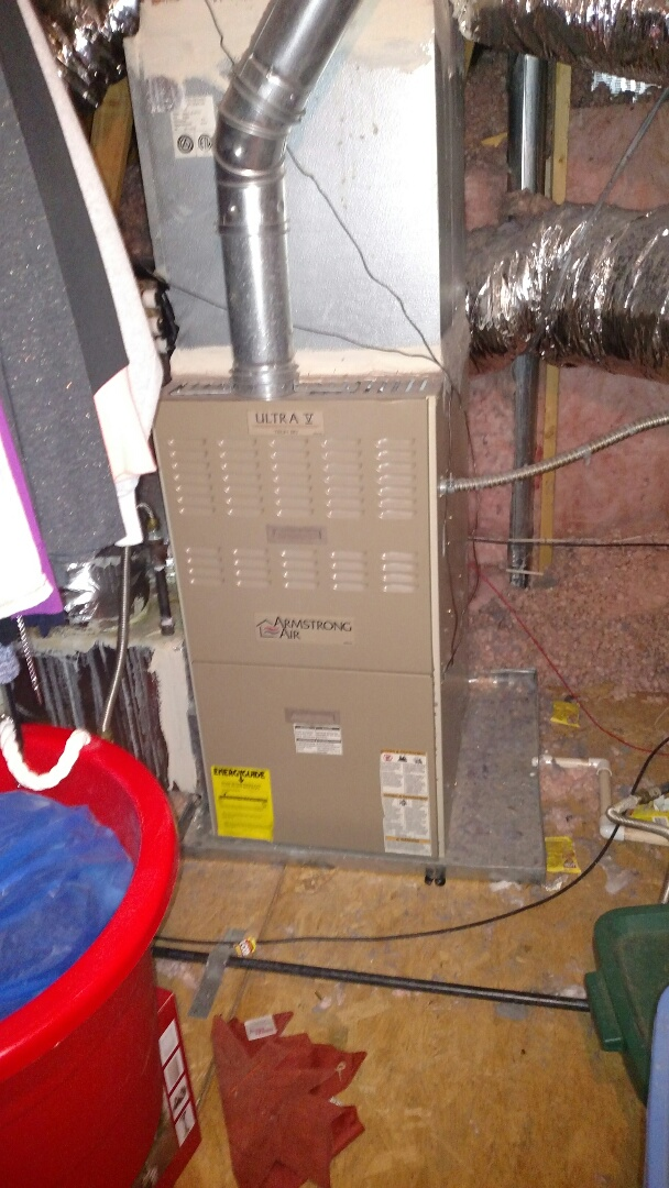 Braselton, GA - Performing heating maintenance on this 16 year old Armstrong 80% natural gas furnace. Changing 16x25x1 pleated filter. We have been servicing this customer for 10 years. We value our longtime customers. Testing for carbon monoxide. Testing heating cycles and temperature output. Also testing safety circuits and burner operations. We are a true family owned and operated local heating and cooling company. We have been servicing this area for over 13 years. We are in or near this area daily.