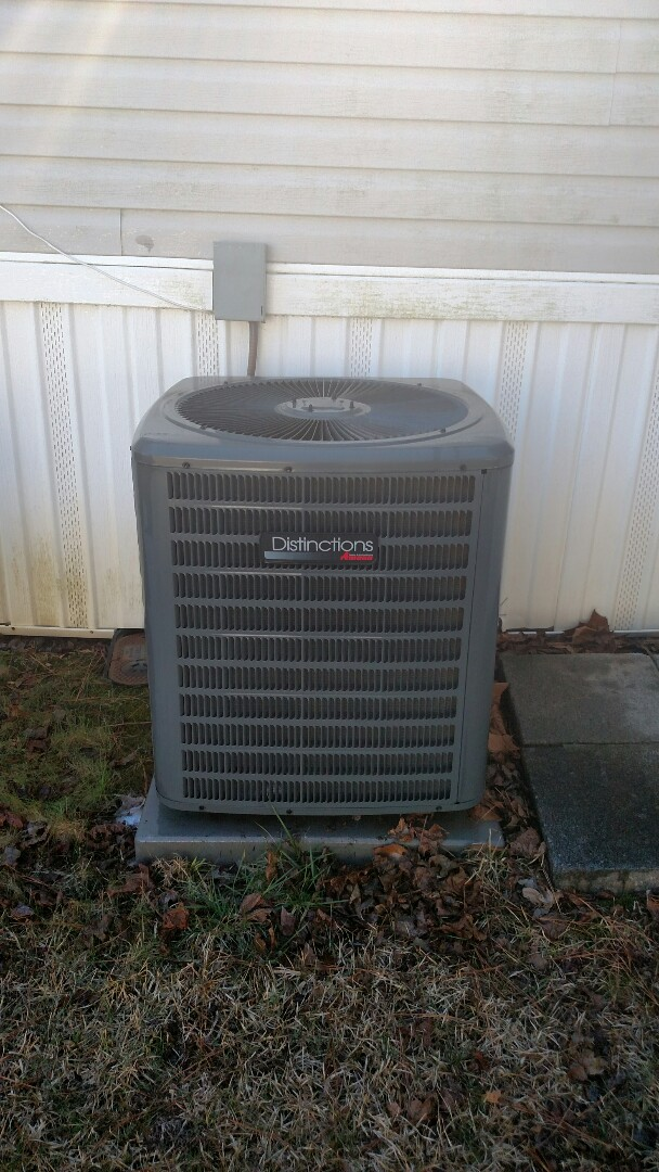 Buford, GA - Performing cooling maintenance on this Amana air conditioner that we installed back in 2012