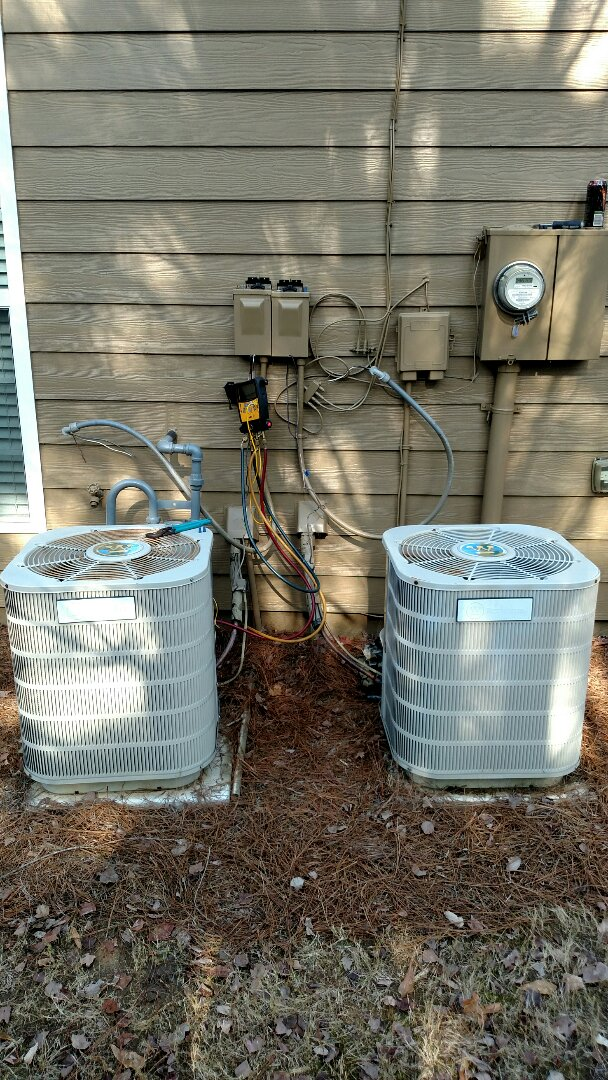 Buford, GA - Replacing these two 2 ton 12 year old Westinghouse central heating and air conditioning systems due to freon leaks. We will be installing 2 14 seer 2 ton Amana central heating and air conditioning systems. We are local and in or near this area on a daily basis. The new Amana air conditioners have a 10 year limited parts warranty. We can install any brand but Amana has the best equipment and warranty department.
