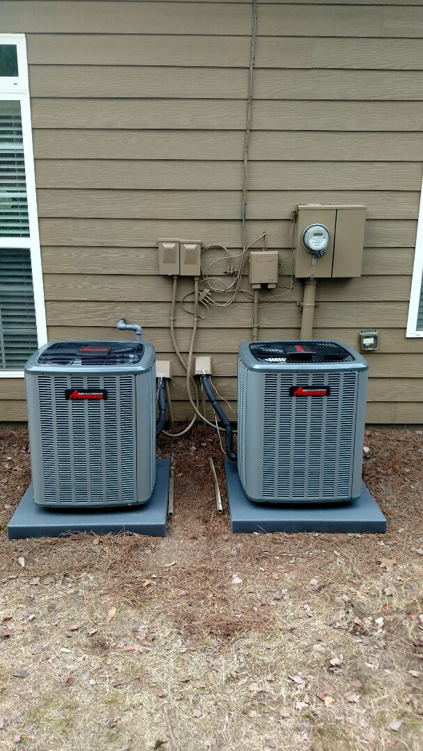 Buford, GA - Here are 2 Brand new 14 seer Amana central heating and cooling systems that we are installing today. They have a 10 year limited parts warranty to registered home owner. We took out 2 12 year old Westinghouse units. We have been servicing the area for over 13 years.