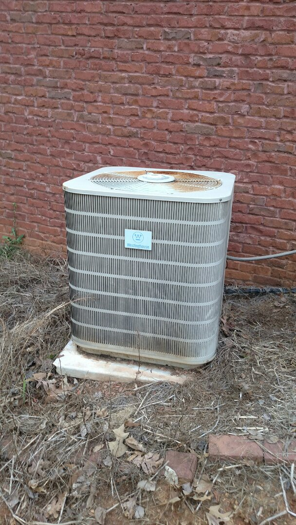 Gainesville, GA - Performing cooling check on this 15 year old Westinghouse central heat pump system. Compressor is in very bad shape and could go out at anytime. We are local and in or near this area on a daily basis. We service all brands like Carrier Bryant Lennox Comfortmaker Nordyne Tappan Westinghouse Trane American standard Ruud Rheem Heil Amana Goodman Daikin GMC Whirlpool weather king. We serve you and your family with honesty and integrity. We are the best in the hall County area give us a call.
