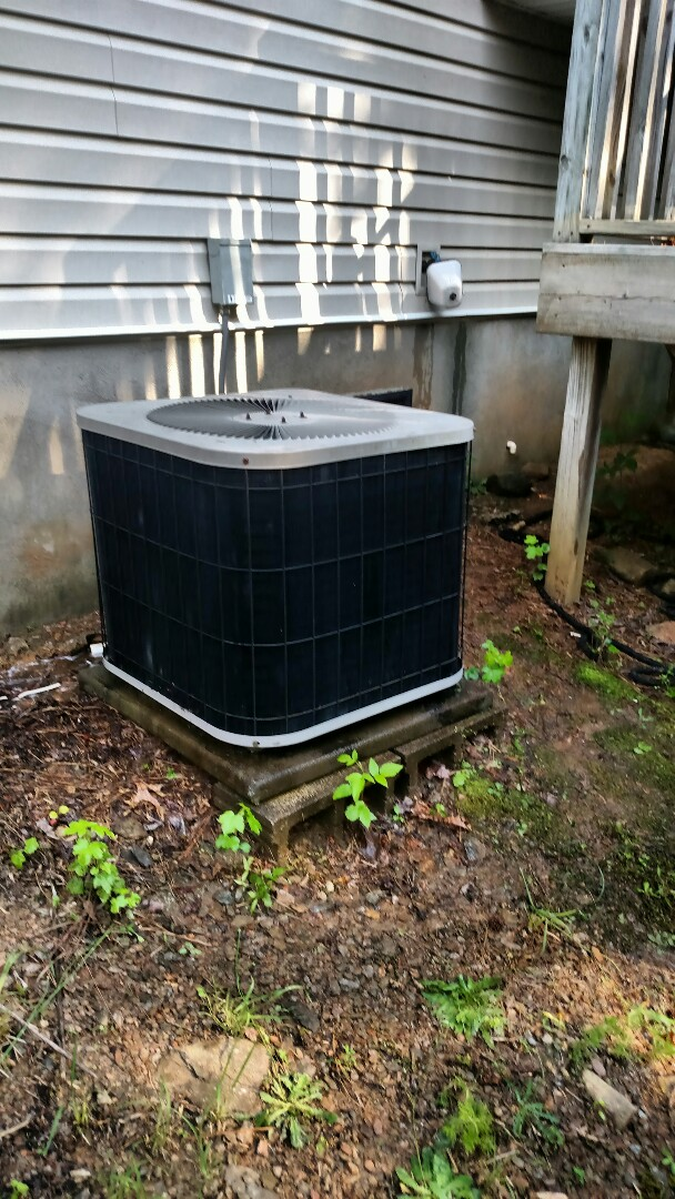 Flowery Branch, GA - This 17 year old Goodman central heat pump system is frozen up due to being low on freon. We service all brands like Carrier Bryant Lennox Comfortmaker Nordyne Tappan Westinghouse Trane American standard Ruud Rheem Heil Amana Goodman Daikin GMC Whirlpool weather king. We are a true family owned and operated heating and air conditioning business. We are your complete service maintenance replacement and warranty specialist. You will see the same two technicians Chris and Chad every visit.