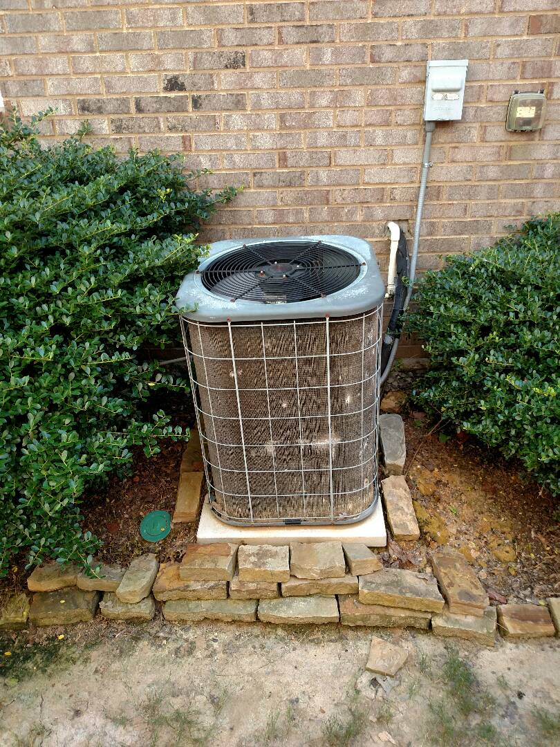 Flowery Branch, GA - Performing cooling check on this 14 year old Amana central heating and cooling system. We service all brands like Carrier Bryant Lennox Comfortmaker Nordyne Tappan Westinghouse Trane American standard Ruud Rheem Heil Amana Goodman Daikin GMC Whirlpool weather king Tempstar. We serve you and your family with honesty and integrity. The best in the Hall County area. Tired of the big companies give us a call. Located in Hall County off of Friendship Road.