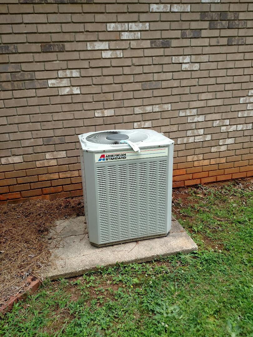 Gainesville, GA - Performing cooling check on this 27 year old American standard central heating and air conditioning system. We service all brands like Carrier Bryant Lennox Comfortmaker Nordyne Tappan Westinghouse Trane American standard Ruud Rheem Heil Amana Goodman Daikin GMC Whirlpool weather king Tempstar. We serve you and your family with honesty and integrity. We are local and in or near this area on a daily basis.