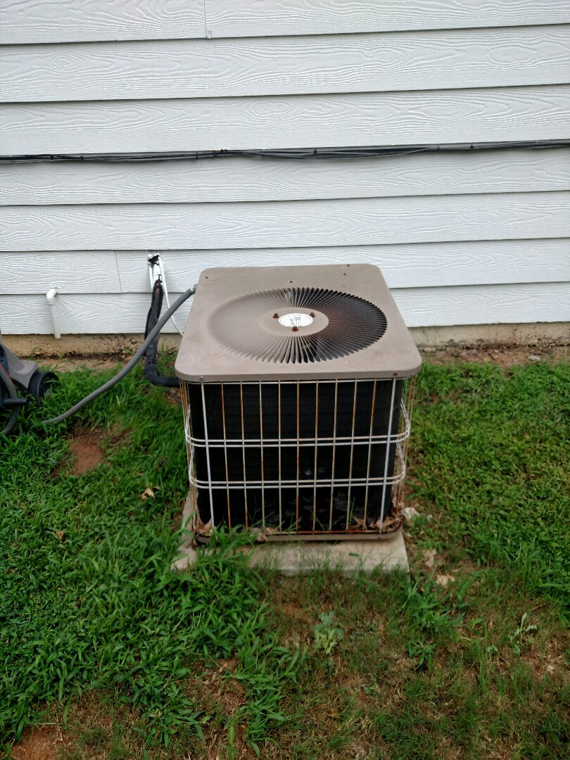 Buford, GA - Performing cooling check on this downstairs 10 seer 15 year old Armstrong central heating and air conditioning system. We are local and in or near this area on a daily basis. We serve you and your family with honesty and integrity. We service all brands like Carrier Bryant Lennox Comfortmaker Nordyne Tappan Westinghouse Trane American standard Ruud Rheem Heil Amana Goodman Daikin GMC Whirlpool weather king Tempstar Armstrong. Residential heating and cooling experts.