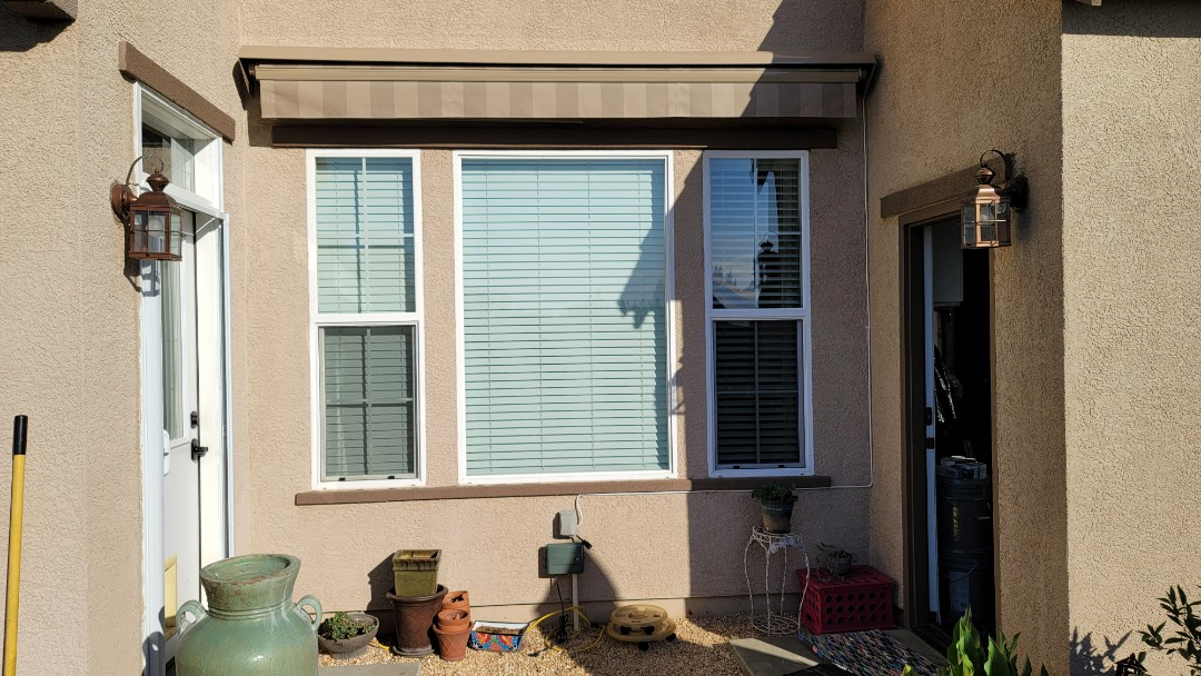 Roseville, CA - Installed a Sunlight retractable awning from Sunesta.  It was their Smartfold model, 10.7' wide x 10 projection.  To do this the arms criss-cross underneath each other.