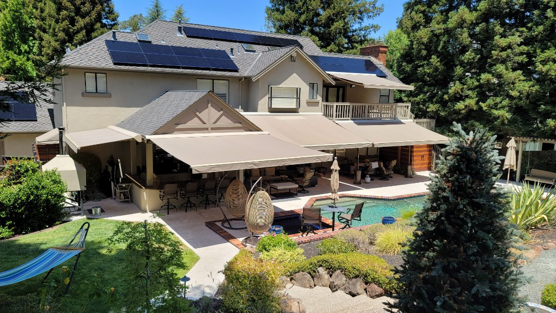Lafayette, CA - Here is a home in Lafayette that has 6 Sunesta Retractable awnings,  5 of which are shown in this picture,  along with a small door, fixed awning on the left side. After getting the first one , the one on the far right, the customer kept adding on so they and their extended family can better enjoy their beautiful yard, barbecue area and pool.