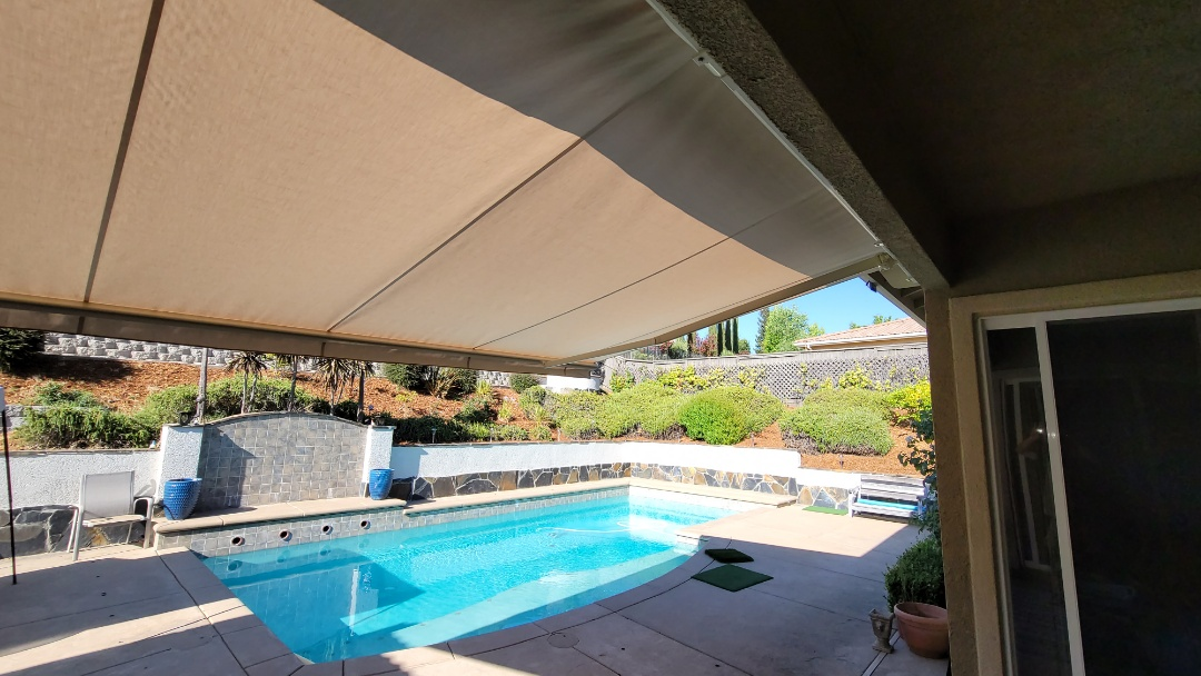 El Dorado Hills, CA - Installed a 18' wide x 10' projection,  retractable awning,  that the customer had purchased.  It was on the north side of the house.  Now during the hottest time of the rear, when the Sun is straight over head, the family can extend their awning to have that cool shade to better enjoy their swimming pool. Everyone loves shade!