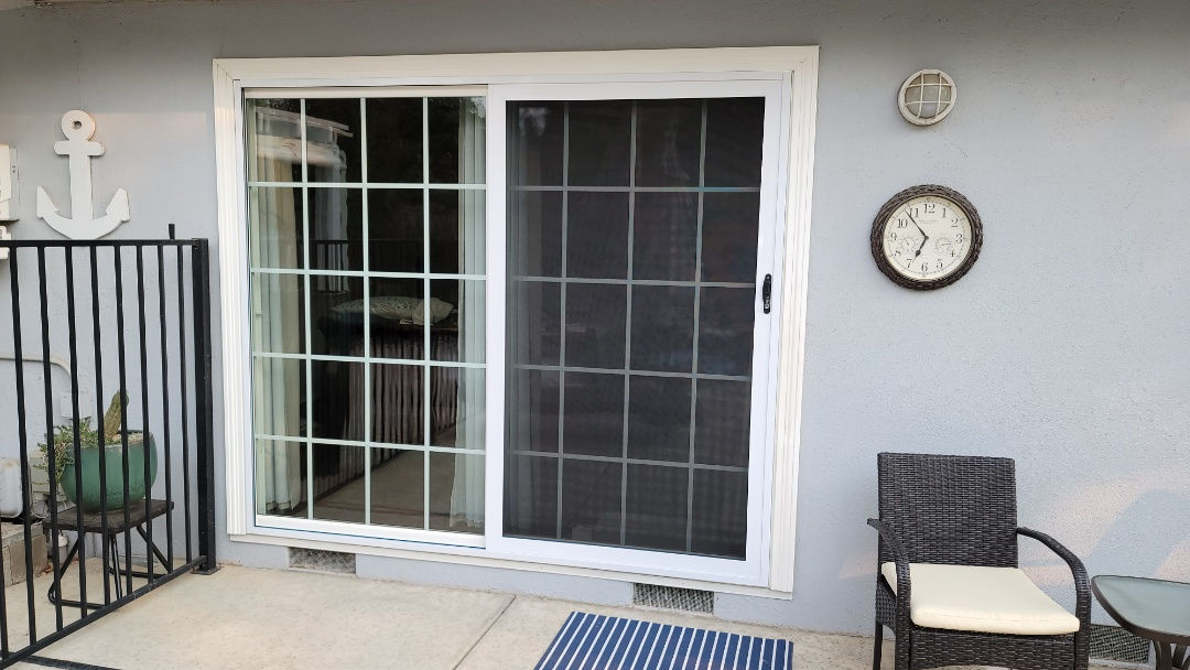Sacramento, CA - Installed security sliding door for customer. This door has a stainless steel mess and 3 locks, the middle one is a dead bolt. The Ono dead bolt side has an interlock system that not only keeps any bugs, Flys or mosquitoes from getting in but locks that side of the door to the fixed frame panel, therefore deterring someone from prying one the door to open it. The door does not move up or down, it has its own tracks , designed to allow the door to slide freely, while allowing the air to flow....