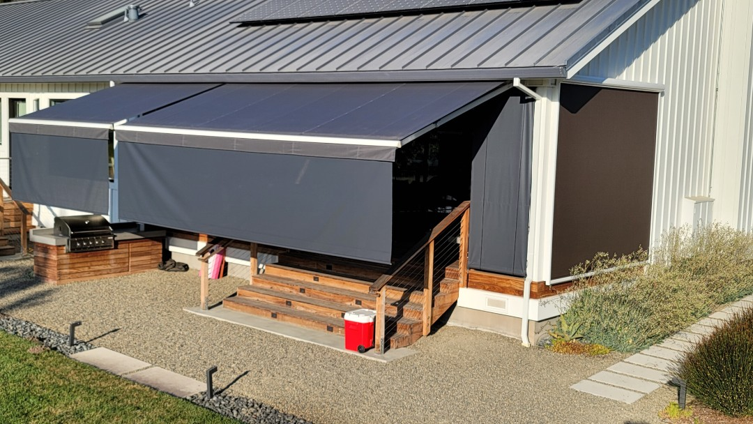 Napa, CA - West facing back deck out in beautiful Napa CA. With the low son its important to have a Retractable awning from Sunesta where they offer a 5' screen that drops out of the front bar of the awning. This awning is the Sunstyle model where one can even motorized this screen. This Waycross the comfort of your chair, you can touch a button on the remote to lower or raise this screen.