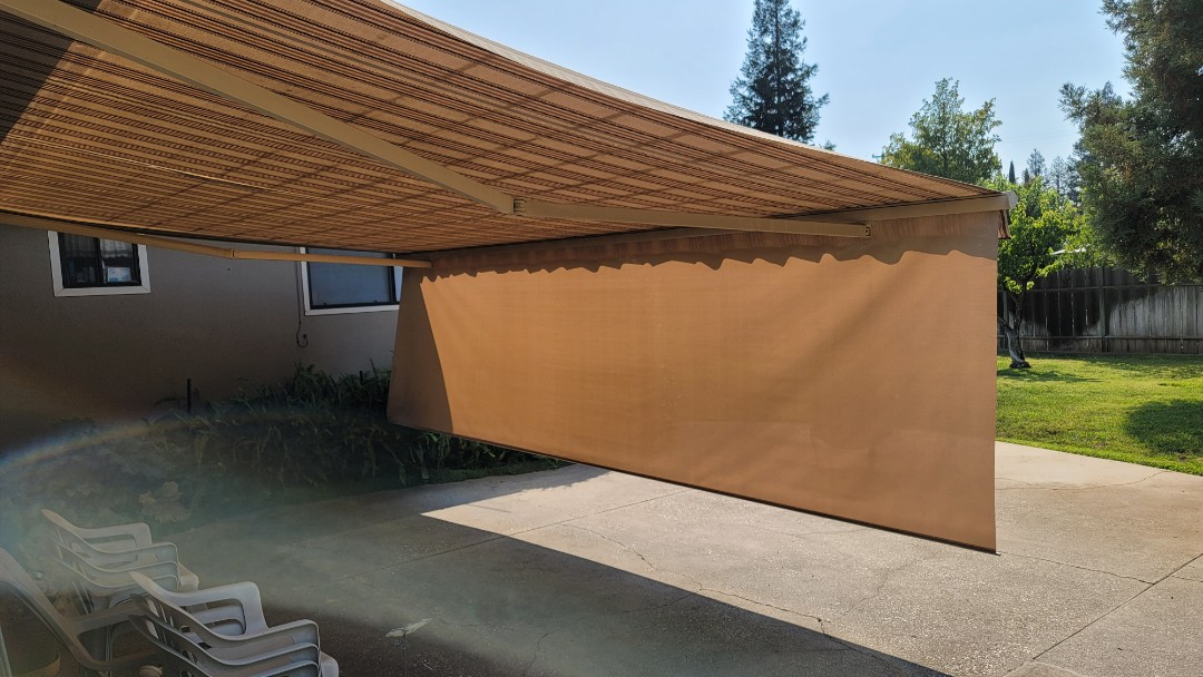 Lincoln, CA - Here us a Sunesta Retractable Awning,  installed in 2008, that needs new fabric. It is 18 x 14.8 with a 5' drop screen,  that drops out of the front bar of the awning to help shade the house and patio from that end of the day sun, that happens every day.
