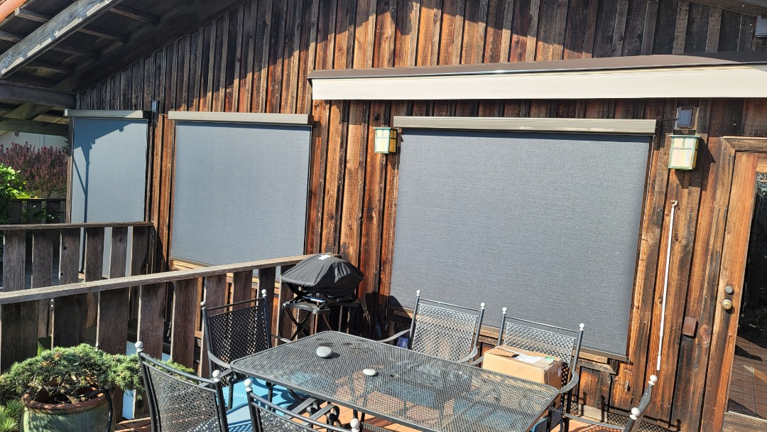 Berkeley, CA - Installed 3 vertical drop screens,  nice extruded aluminum cases. The fall bar was guided down by steel cables. The screen is a 95% , 5% openness,  to block that west sun, but allow them to enjoy their view of San Francisco and both bridges.