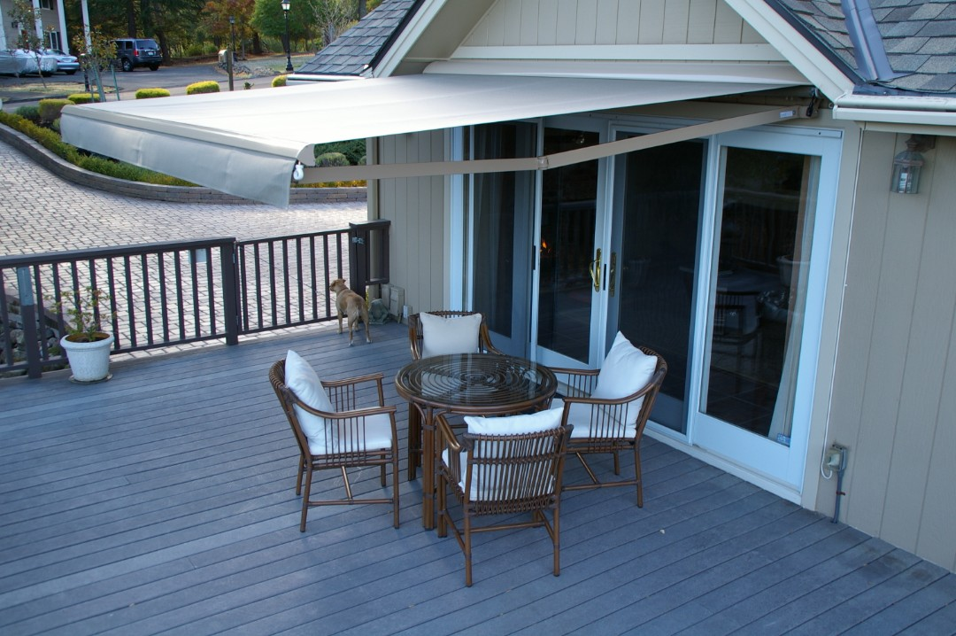 Rocklin, CA - Another back yard with a nice wood deck but no shade. They have chosen a Sunesta Retractable Awning.