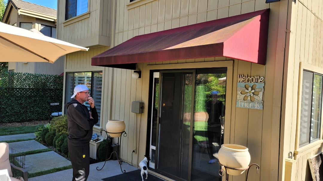 """Danville, CA - A west facing backyard that is going to have a completely new look, starting out with a large Sunesta Retractable Awning,  23' wide x 14'8"""" projection and a 5' motorized drop screen to help block that late afternoon sun....and remove the door ,fixed awning."""