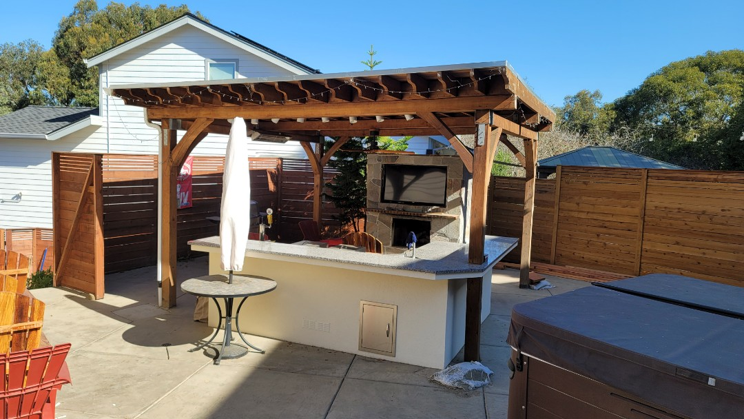 """Hayward, CA - This is a real nice structure that needs shade.  The customer ordered a 15' x 8'3"""" projection Sunesta Retractable Awning,  with a 5' manual drop screen . He also ordered roll curtains for the 3 other sides to protect against sun, wind and rain."""