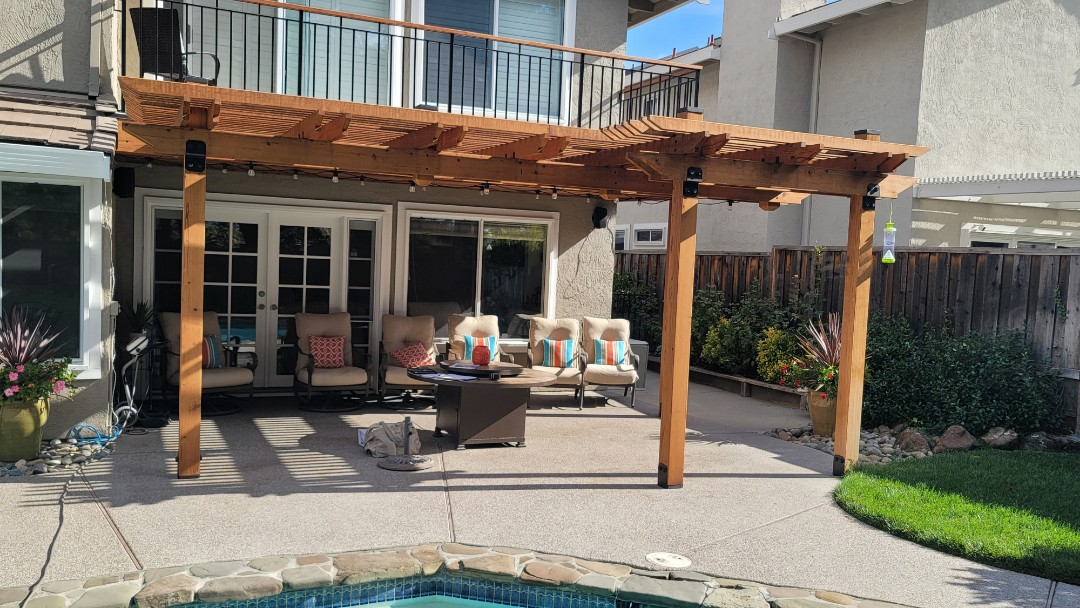 San Ramon, CA - Beautiful wood pergola where Sun invades their patio from all 3 sides. Vertical drop screens will block the sun while maintaining their view.
