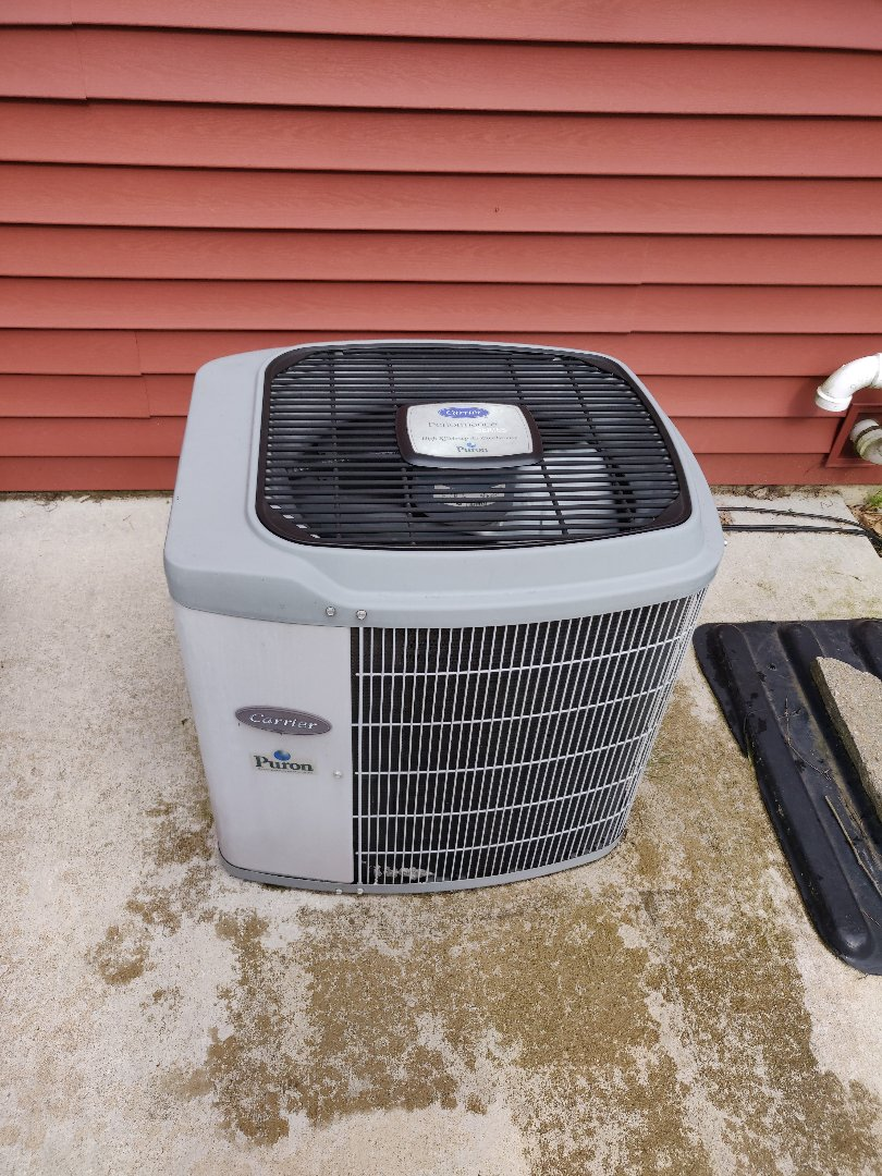 Battle Creek, MI - Added 410a or puron to this carrier ac unit. Cleaned condenser coils.