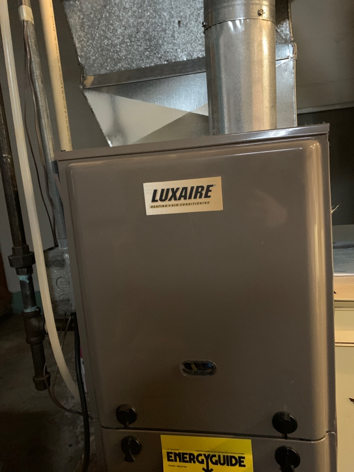 No heat repair on a Luxaire gas furnace. Cleaning of the flame sensor was performed.