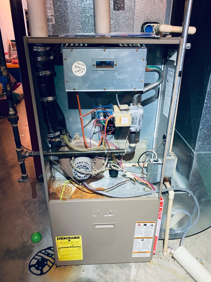 No heat repair, condensation leaking from draft inducer. Armstrong gas furnace.  Install condensation hose trap.