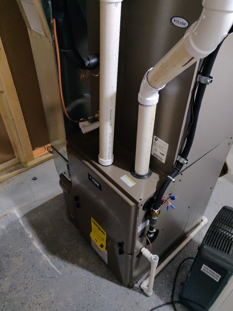 Battle Creek, MI - Furnace tune up replace media filter and humidifier pad.
