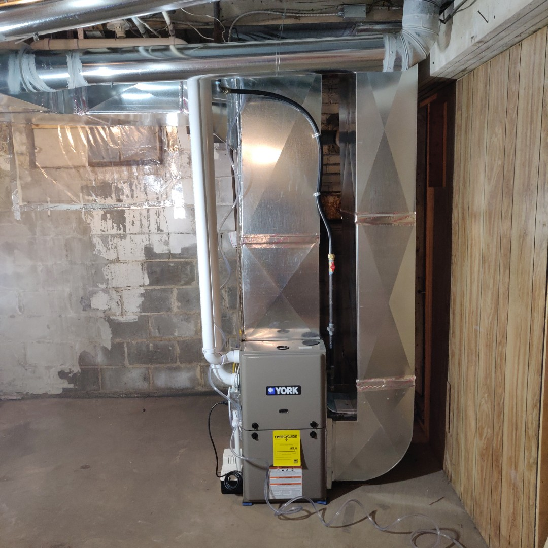 Battle Creek, MI - Replace old furnace with a York TM9E with New duct work.