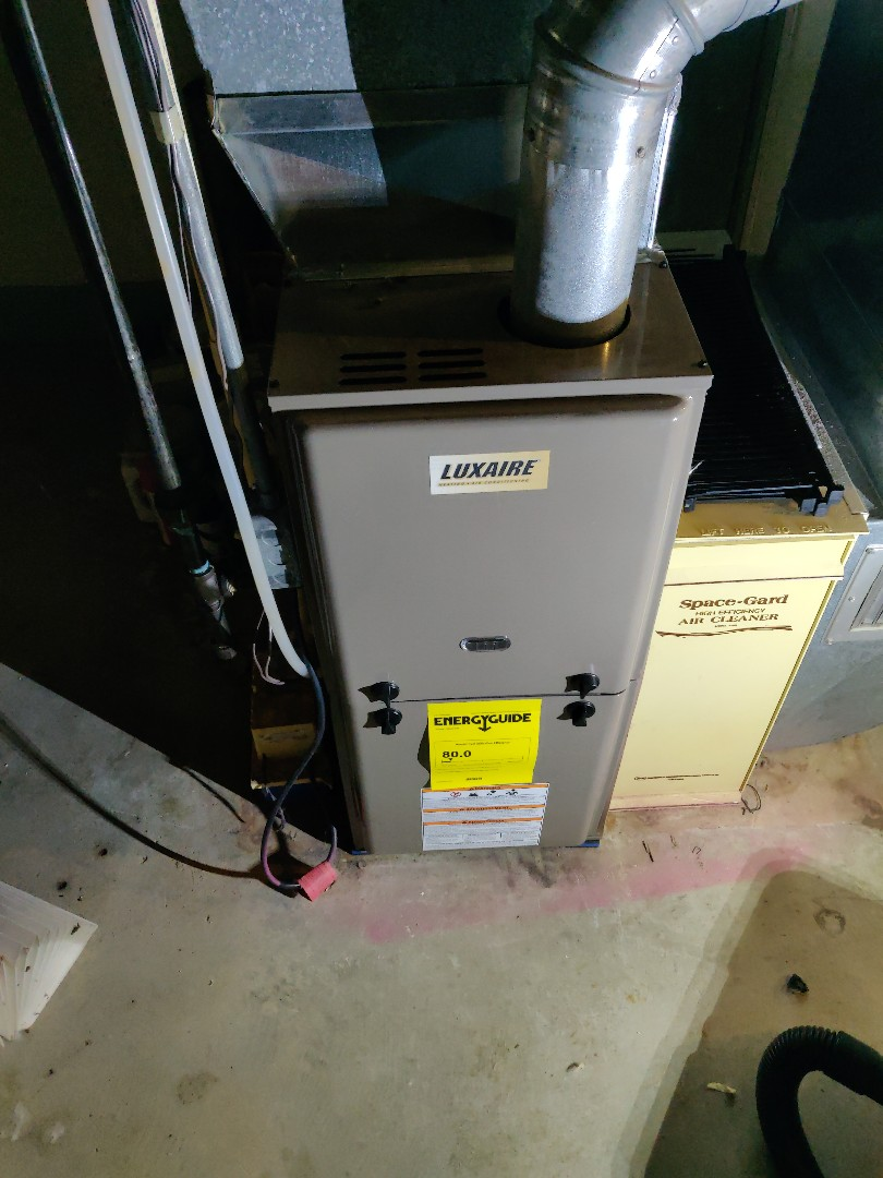 Battle Creek, MI - Clean flame sensor on a luxaire gas furnace.