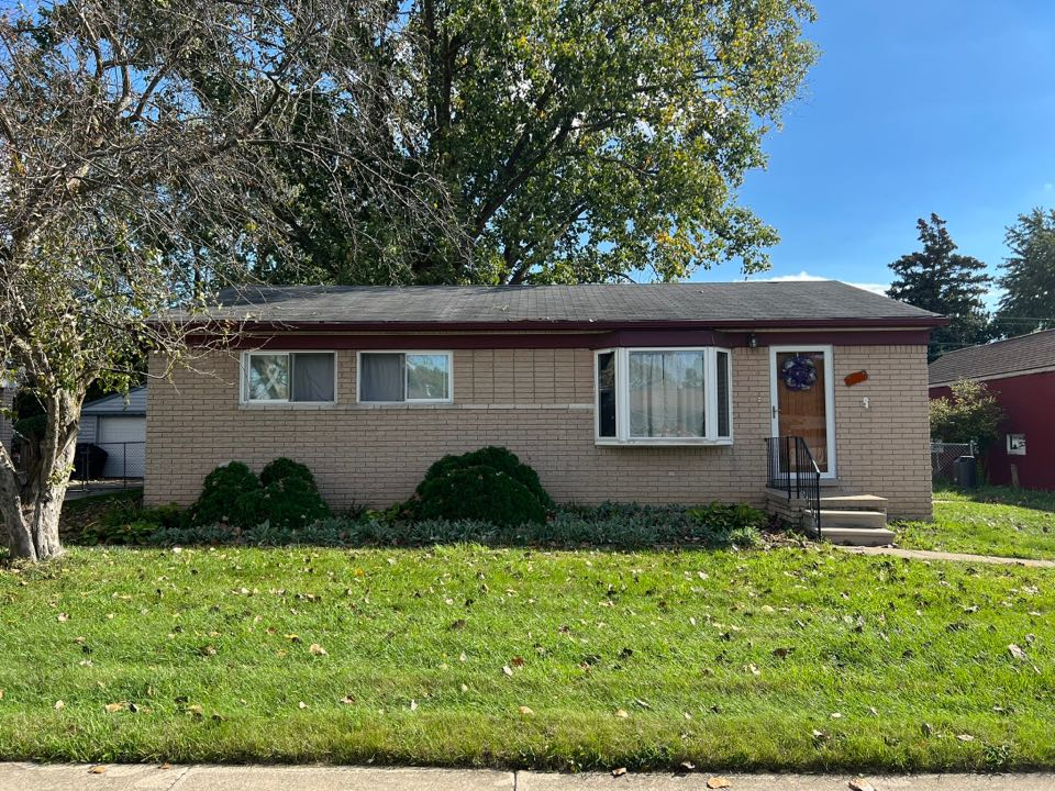 Clinton Township, MI - Giving a free estimate to a customer to have their old roof torn off and replaced with GAF Timberline Architectural Shingles.