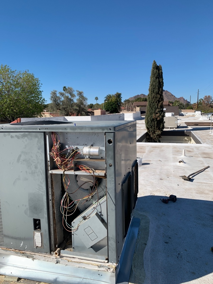 Scottsdale, AZ - Installing new roof curb to eliminate water leaks on existing Goodman heat pump.