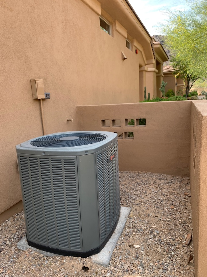Scottsdale, AZ - Making sure nothing stops this Trane.  Pre summer tune up on split Trane heat pump system in McDowell Mountain community