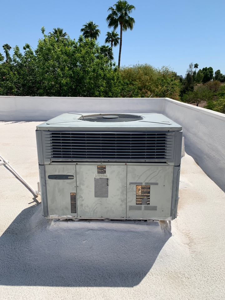 Scottsdale, AZ - Performing pre summer check up on Trane package heat pump.  Nothing can stop a Trane.  15 years old and running strong!!!