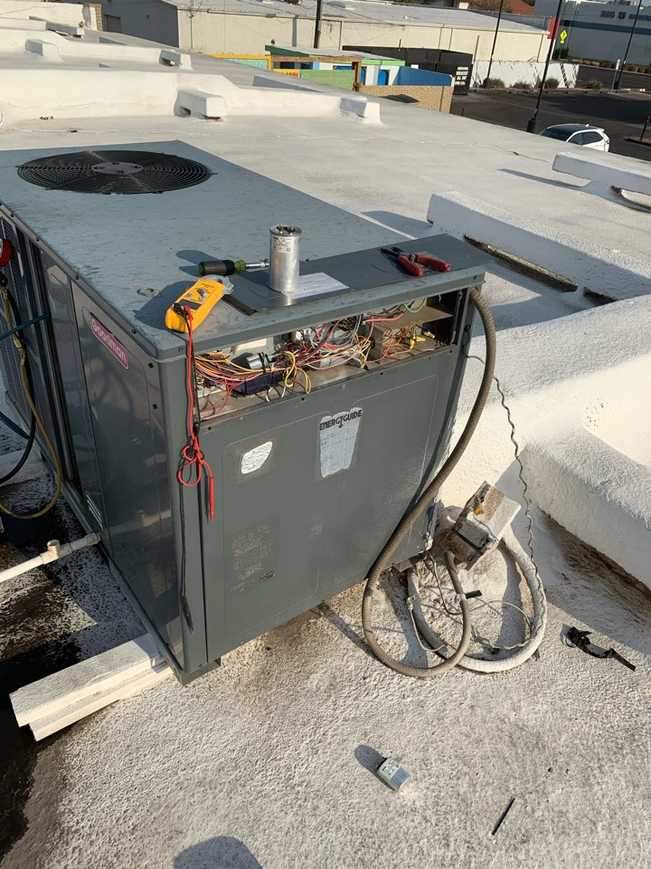 Phoenix, AZ - Installing new run capacitor In air conditioner due to the fact the old one was totally weak and not starting the compressor.