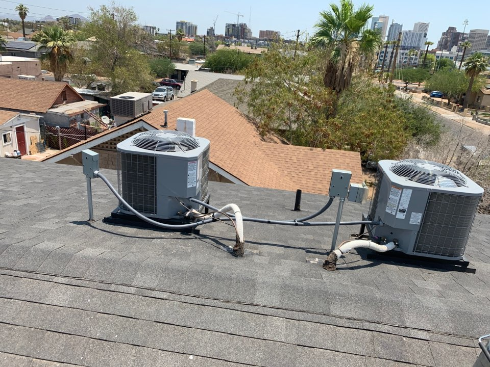 Phoenix, AZ - These air conditioning units main power wiring was not hook up right. Swapped wiring to right condensers. Also cleaned one indoor blower wheel that was filled with dirt and grime.