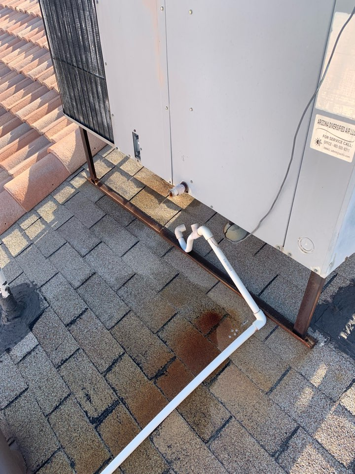 Phoenix, AZ - This Air conditioning units drain line fell off during the storm last week. Reattached the pipe. Now water is not running on the roof.
