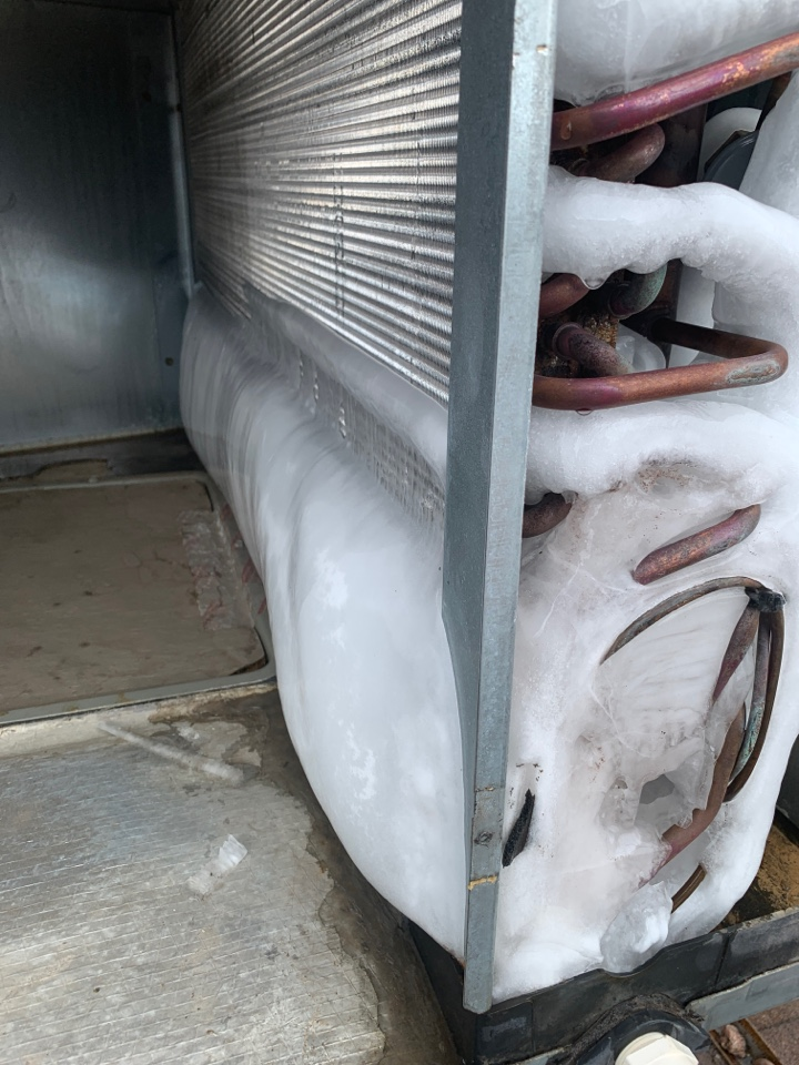 Tempe, AZ - Found Trane package unit frozen over.  Defrosting coil.  Found system low on charge due to leaky service port.  Charged system and back up and cooling