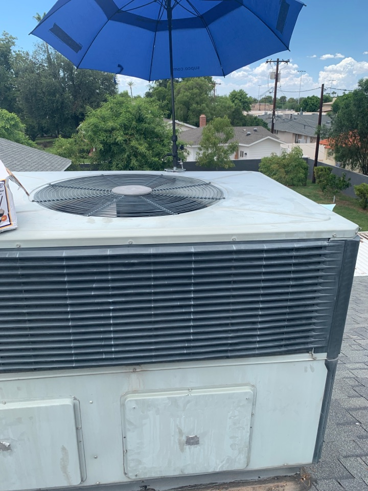Phoenix, AZ - Replacing a faulty condenser fan motor and run capacitor on Trane package heat pump.   System back up and cooling within specs