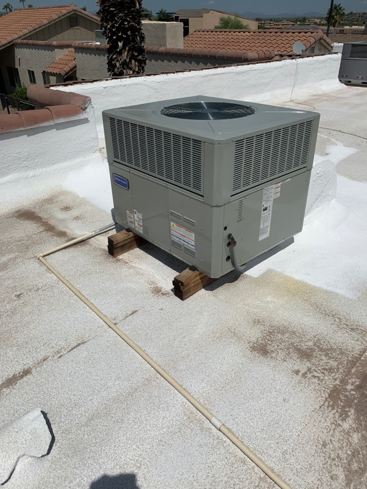 Fountain Hills, AZ - Installed rubber isolation pads under American standard package heat pump to reduce noise transfer into building.