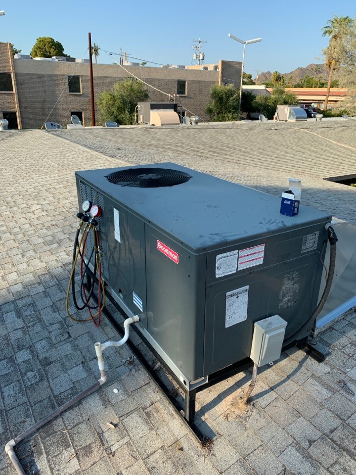 Phoenix, AZ - Inspected Goodman package air conditioner to see why it is costing more to run it. Found dual run capacitor getting week which causes motors to work harder. Replaced run cap bringing amperage a down.