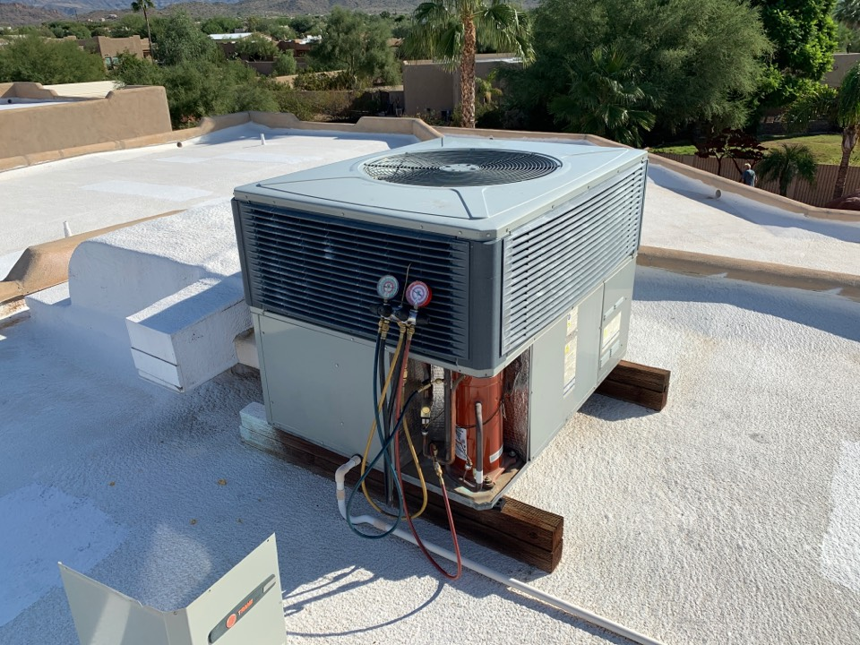 Phoenix, AZ - Conducting inspection on Trane air conditioner for new home owner during sale.