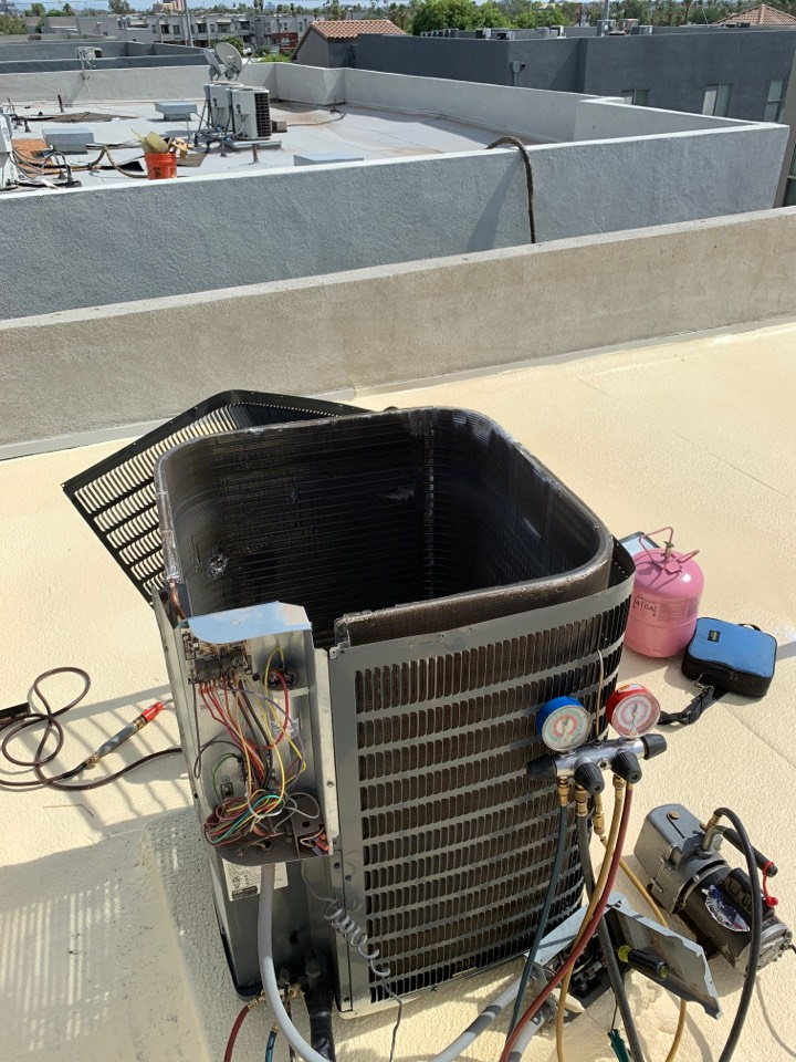 Phoenix, AZ - Repairing hole in outdoor coil on a Goodman split airconditioner.