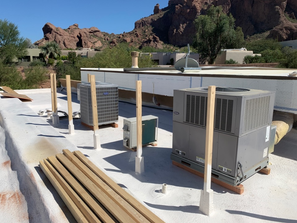 Phoenix, AZ - Moving carrier air conditioners back after roofers foamed roof on remodel.