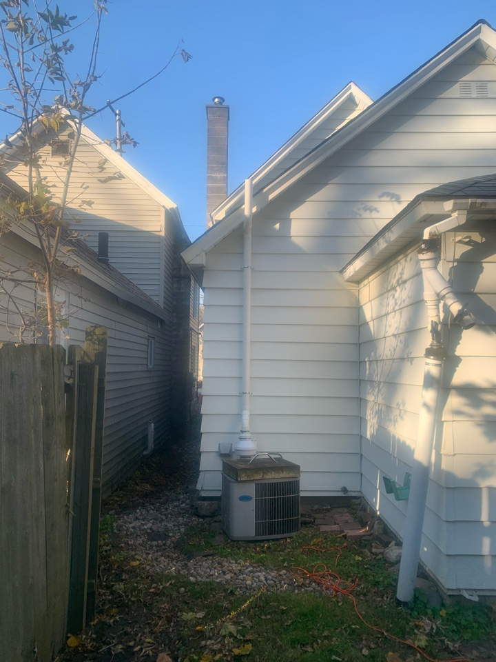 Grand Rapids, MI - Dangerous levels of radon gas can be found in any home regardless of how old or new it is. This picture is of a radon mitigation system we installed in a house in the city of Grand Rapids Michigan.