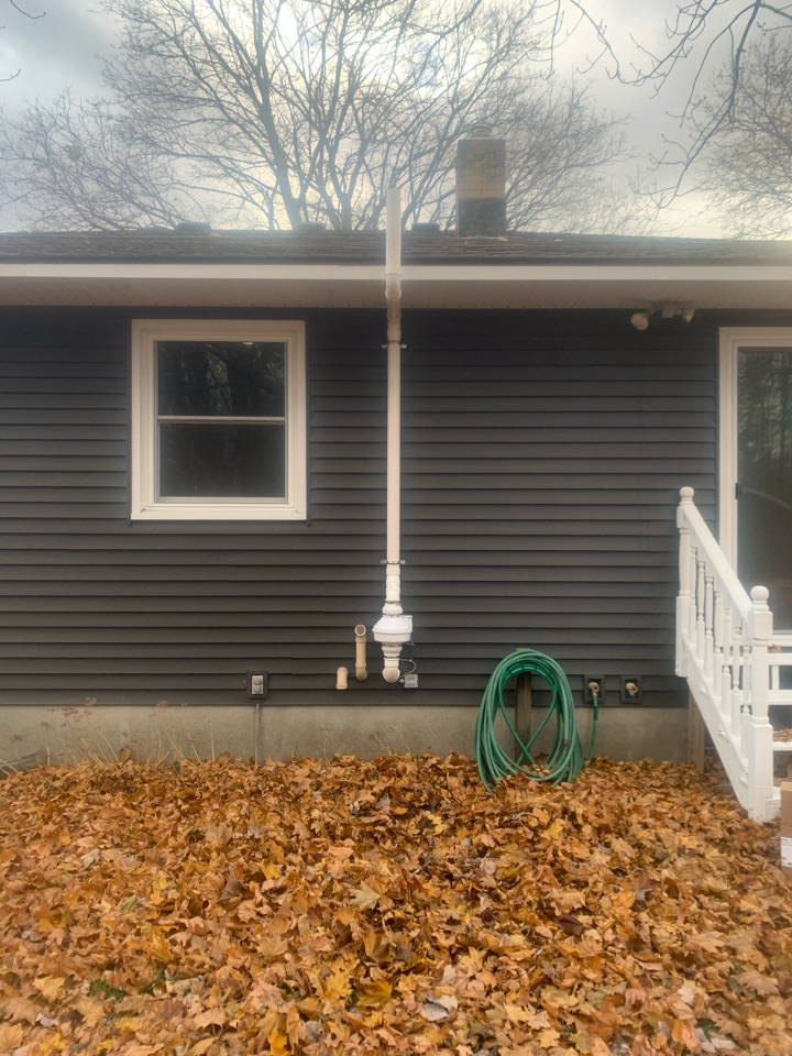 Wyoming, MI - This is a picture of a radon mitigation system mounted on the outside of a house. This job was for a real estate deal. The home inspector did a radon test and the levels came back high so we installed the radon system for the new homeowners to make sure they are safe from radon gas.